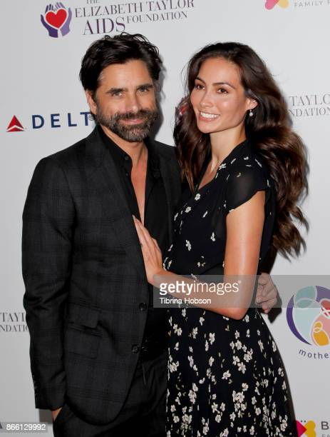 John Stamos and Caitlin McHugh attend the mothers2mothers and The Elizabeth Taylor AIDS Foundation Benefit Dinner on October 24 2017 in Beverly Hills...