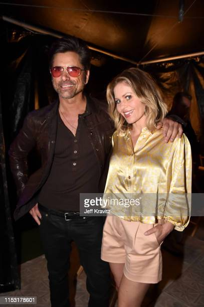John Stamos and Candace CameronBure attend 2019 iHeartRadio Wango Tango presented by The JUVÉDERM® Collection of Dermal Fillers at Dignity Health...