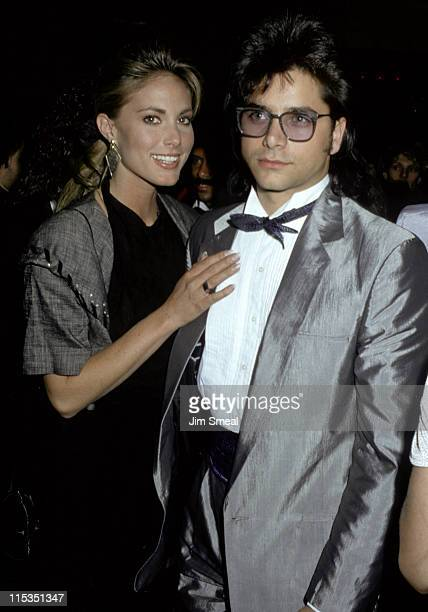 John Stamos and Date during 15th Annual American Music Awards January 251988 at Shrine Auditorium in Los Angeles California United States