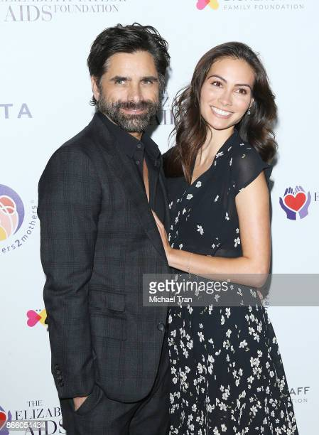 John Stamos and fiancee Caitlin McHugh attend the mothers2mothers and ETAF event held on October 24 2017 in Beverly Hills California