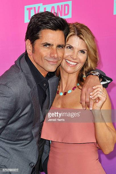 John Stamos and Lori Loughlin arrive at the TV Land Icon Awards at The Barker Hanger on April 10 2016 in Santa Monica California