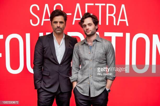 John Stamos and Penn Badgley discuss 'You' during SAGAFTRA Foundation Conversations at The Robin Williams Center on October 16 2018 in New York City