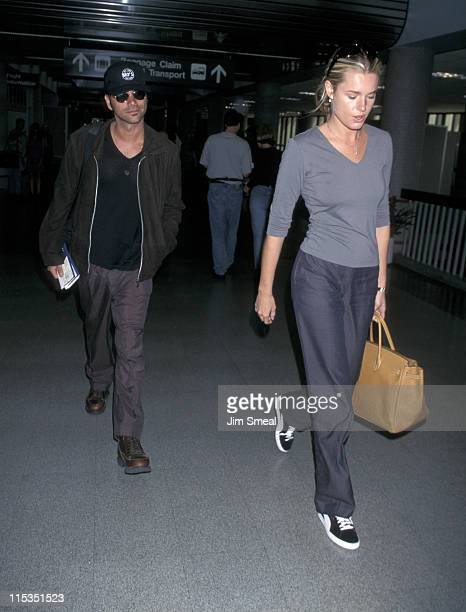 John Stamos and Rebecca Romijn during John Stamos and Rebecca Romijn Leaving LAX For Miami May 31 1998 at Los Angeles International Airport in Los...