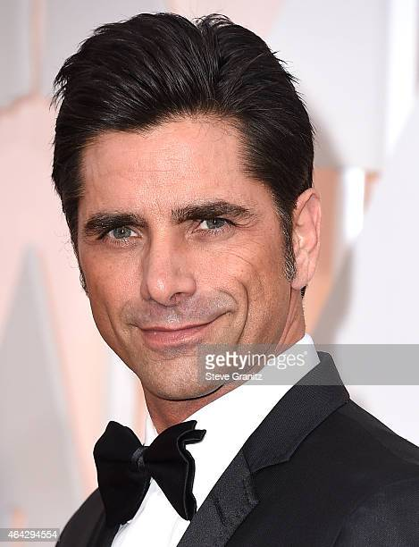 John Stamos arrives at the 87th Annual Academy Awards at Hollywood Highland Center on February 22 2015 in Hollywood California