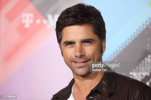 John Stamos arrives at the TMobile Sidekick 4G launch party held at 9900 Wilshire Blvd on April 20 2011 in Beverly Hills California