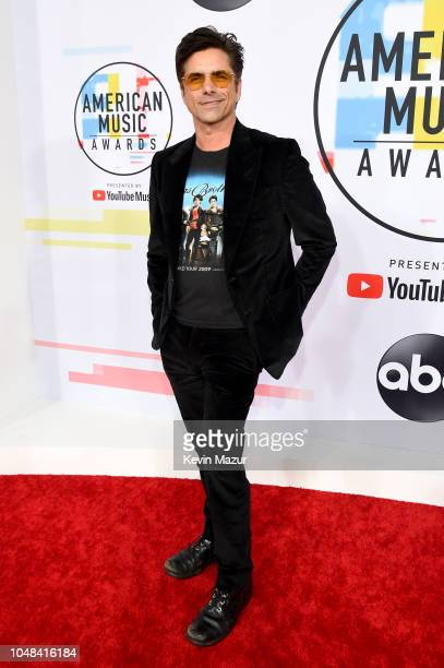 John Stamos attends the 2018 American Music Awards at Microsoft Theater on October 9 2018 in Los Angeles California
