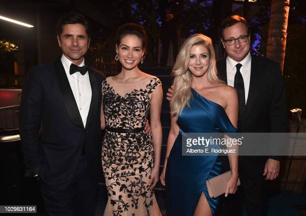 John Stamos Caitlin McHugh Kelly Rizzo and Bob Saget attend the 2018 Creative Arts Emmys Ball on September 8 2018 in Los Angeles California