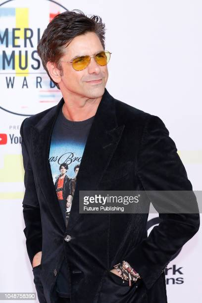 John Stamos photographed on the red carpet of the 2018 American Music Awards at the Microsoft Theater on October 9 2018 in Los Angeles USA