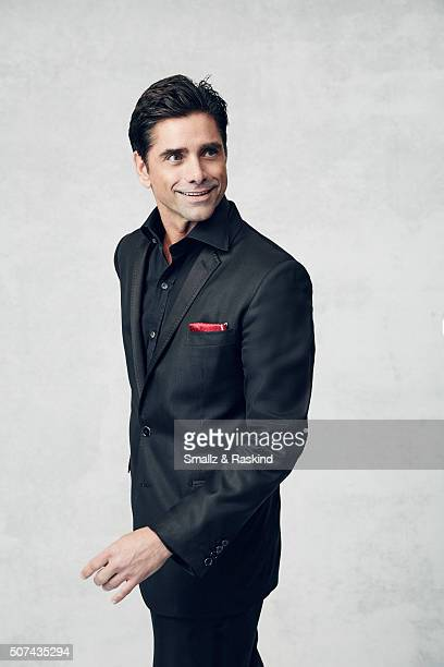 John Stamos poses for a portrait during the 21st Annual Critics' Choice Awards at Barker Hangar on January 17 2016 in Santa Monica California