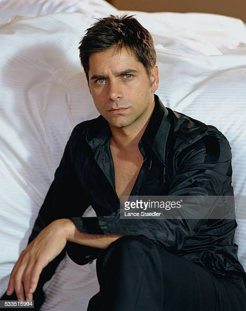 John Stamos Seated Beside Bed