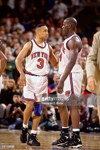John Starks and Anthony Mason of the New York Knicks talk on the court during Game Five of the NBA Finals played on June 17, 1994 at Madison Square...