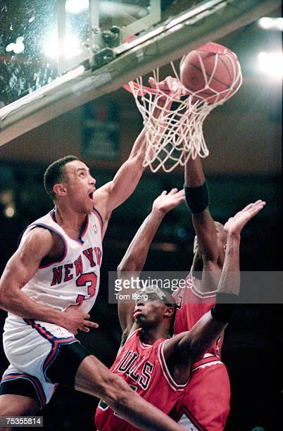 John Starks going up over Bulls Michael Jordan and Bulls Horace Grant with a Left handed dunk The Dunk photo taken at Madison Square Garden