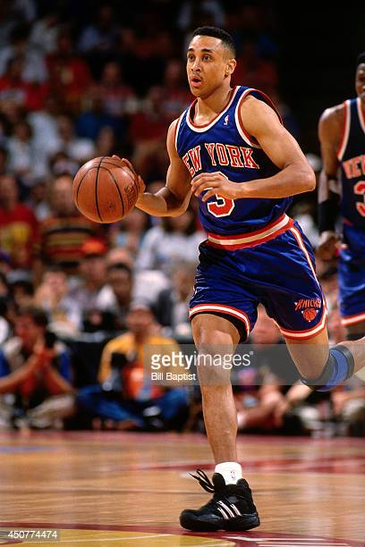 John Starks of the New York Knicks dribbles the ball up court during Game Six of the NBA Finals against the Houston Rockets on June 19 1994 at The...