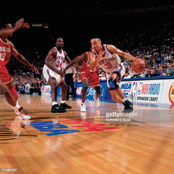 John Starks of the New York Knicks drives to the basket against the Houston Rockets during Game Five of the NBA Finals played June 17 1994 at Madison...