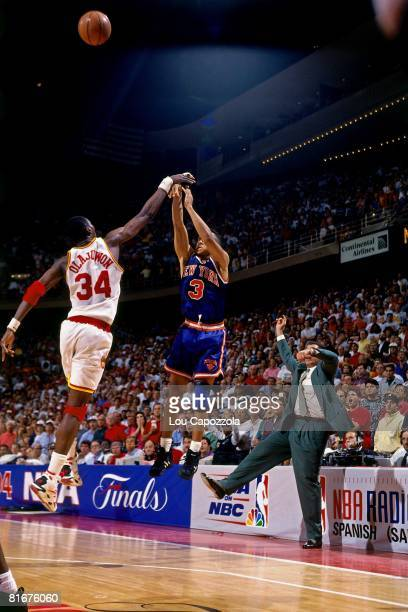 John Starks of the New York Knicks has his threepoint shot blocked by Hakeem Olajuwon of the Houston Rockets in Game Six of the 1994 NBA Finals at...