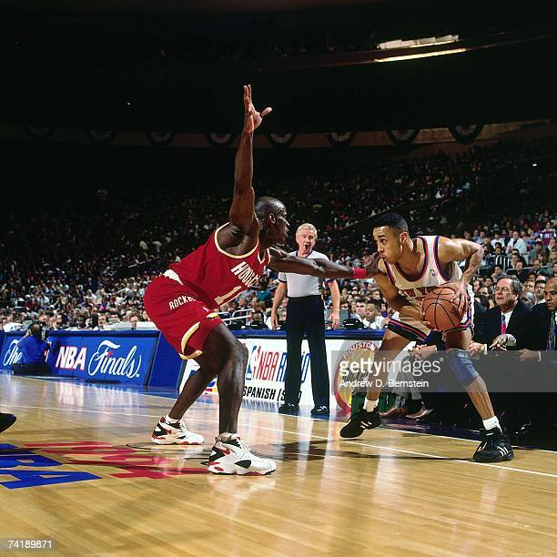 John Starks of the New York Knicks prepares to make a move against Vernon Maxwell of the Houston Rockets during Game Three of the NBA Finals played...