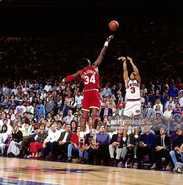 John Starks of the New York Knicks shoots ove Hakeem Olajuwon of the New York Knicks during Game Three of the NBA Finals played on June 12 1994 at...