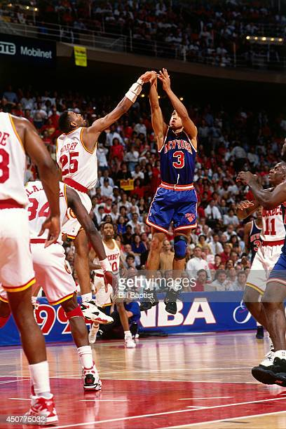 John Starks of the New York Knicks shoots the ball during Game Seven of the NBA Finals against the Houston Rockets on June 22 1994 at The Summit in...
