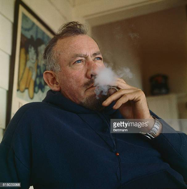 John Steinbeck, Author and Nobel Prize winner, ponders a question during an interview at his Sag Harbor, L.I. Home. He will go to Sweden in December...