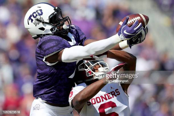 John Stephens Jr. #7 of the TCU Horned Frogs pulls in a pass against Tre Brown of the Oklahoma Sooners in the second half at Amon G. Carter Stadium...