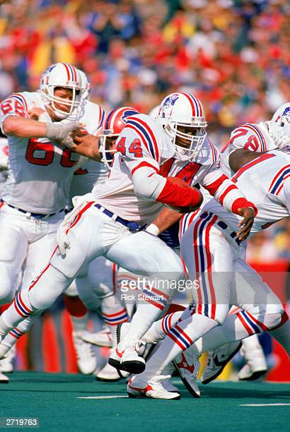 John Stephens of the New England Patriots rushes during a NFL game against the Buffalo Bills at Rich Stadium on October 23, 1988 in Buffalo, New...