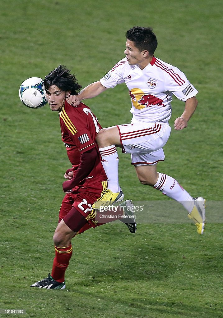 John Stertzer #27 of Real Salt Lake attempts to control the ball pressured by Connor Lade #16 of the New York Red Bulls during the first half of the FC Tucson Desert Diamond Cup at Kino Sports Complex on February 13, 2013 in Tucson, Arizona.