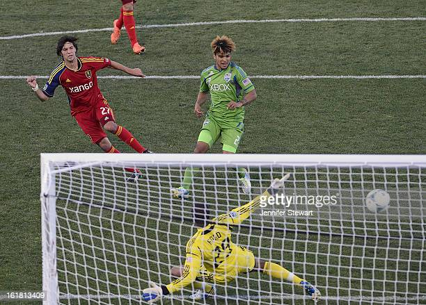 John Stertzer of Real Salt Lake scores a goal in the second half on goalkeeper Josh Ford during the FC Tucson Desert Diamond Cup at Kino Sports...