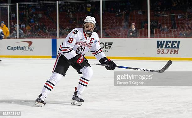 John Stevens of the Northeastern Huskies skates against the New Hampshire Wildcats during NCAA hockey at Fenway Park during 'Frozen Fenway' on...