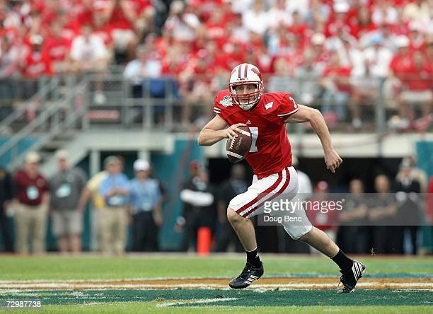 John Stocco of the Wisconsin Badgers runs with the ball against the Arkansas Razorbacks in the Capitol One Bowl at Florida Citrus Bowl on January 1,...