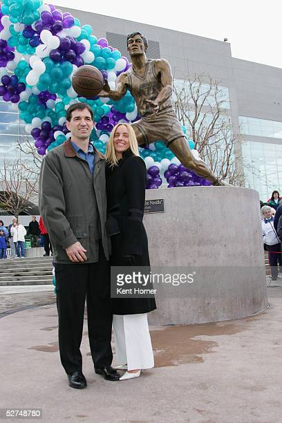 John Stockton and his wife Nada pose for a photo at the unveiling of a 9foot bronze statue of Stockton a former Utah Jazz point guard outside the...