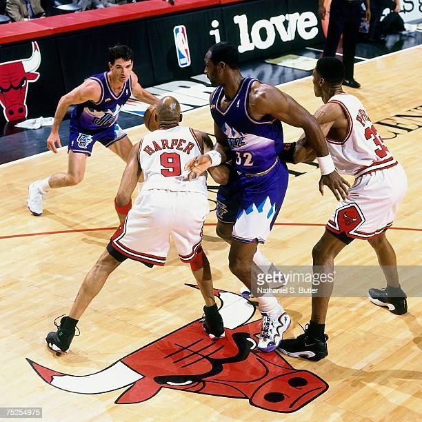 John Stockton and Karl Malone of the Utah Jazz run a pick and roll against Ron Harper and Scottie Pippen of the Chicago Bulls in Game Four of the...