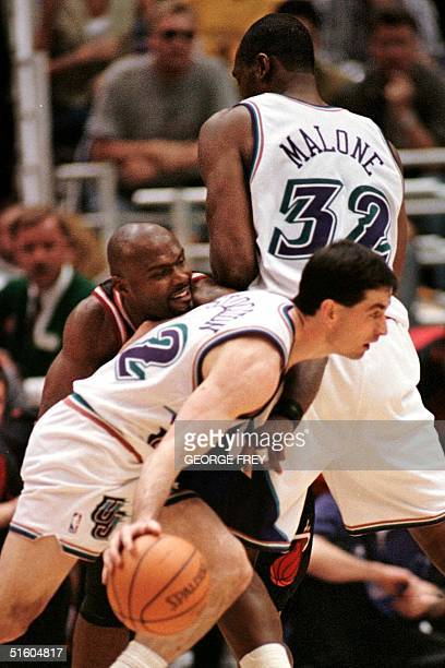 John Stockton and Karl Malone of the Utah Jazz run a pickandroll on Tim Hardaway of the Miami Heat in Salt Lake City UT 23 March 1999 Utah defeated...