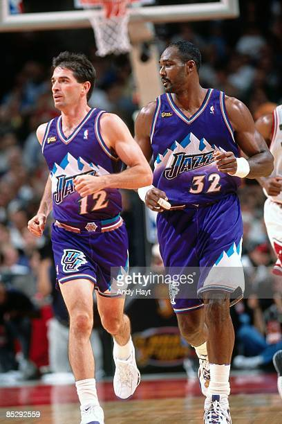 John Stockton and Karl Malone of the Utah Jazz run up court during Game Four of the 1998 NBA Finals against the Chicago Bulls played on June 10, 1998...