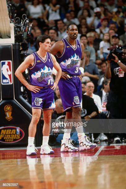 John Stockton and Karl Malone of the Utah Jazz stand on the court during Game Four of the 1998 NBA Finals against the Chicago Bulls played on June 10...