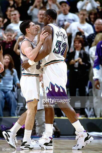 John Stockton and Karl Malone of the Utah Jazz talk about a play during an NBA game against the Detroit Pistons on March 7 1997 at the Delta Center...