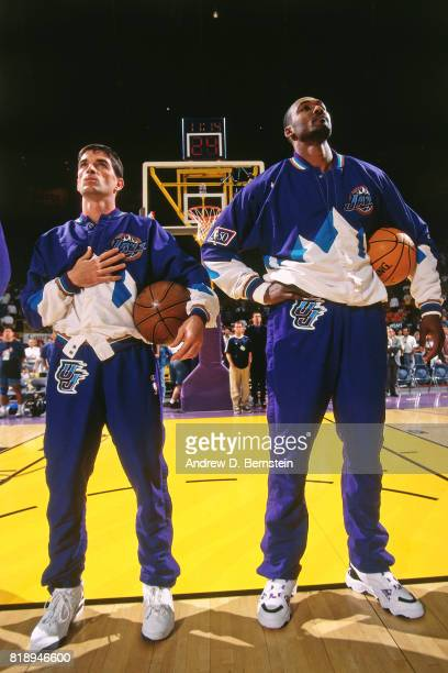 John Stockton and Karl Malone stand on the court before a game against the Los Angeles Lakers during Game Three of the Western Conference...