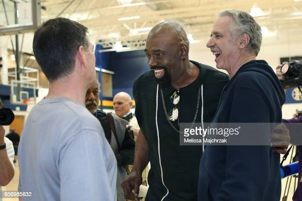 John Stockton Antoine Carr and Phil Johnson former Assistant Coach of the Utah Jazz talk to each other during a press interview about the 1997...