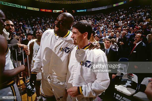 John Stockton of the Utah Jazz and Antoine Carr smile against the Denver Nuggets on February 1 1995 at the Delta Center in Salt Lake City Utah John...