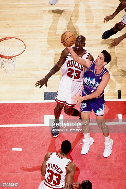 John Stockton of the Utah Jazz attempts a layup against Michael Jordan of the Chicago Bulls in Game Five of the 1998 NBA Finals at the United Center...
