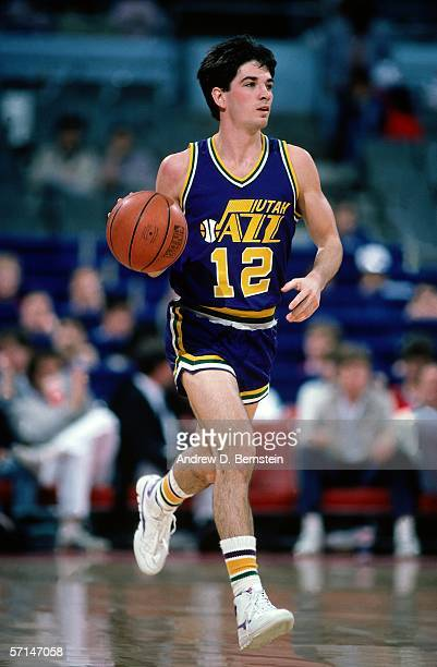John Stockton of the Utah Jazz brings the ball upcourt during the NBA game circa 1986. NOTE TO USER: User expressly acknowledges and agrees that, by...
