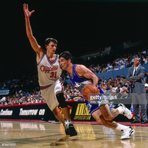 John Stockton of the Utah Jazz dribbles against the Los Angeles Clippers during Game Three of the First Round of the 1997 NBA playoffs on April 28...