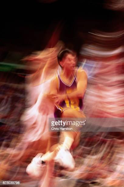 John Stockton of the Utah Jazz drives to the basket and passes the ball against the Atlanta Hawks at the Omni Coliseum in Atlanta Georgia circa 1992...