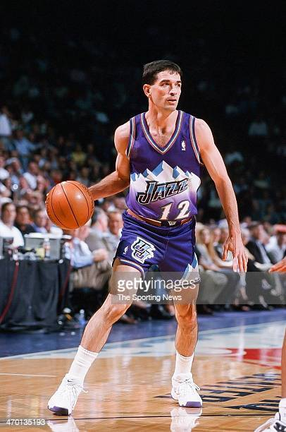John Stockton of the Utah Jazz moves the ball during the game against the Houston Rockets on April 30, 1999 at Compaq Center in Houston, Texas.