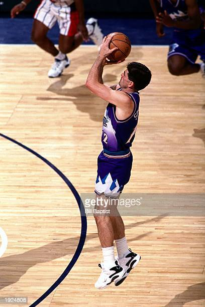 John Stockton of the Utah Jazz takes the game winning jump shot against the Houston Rockets during Game Six of the Western Conference Finals on May...