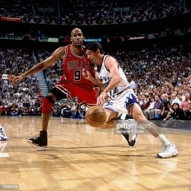 John Stockton of Utah Jazz drives to the basket against Ron Harper of the Chicago Bulls in Game Six of the 1998 NBA Finals against the Chicago Bulls...