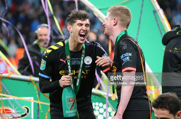 John Stones and Kevin De Bruyne of Manchester City celebrate after victory over Aston Villa in the Carabao Cup Final between Aston Villa and...