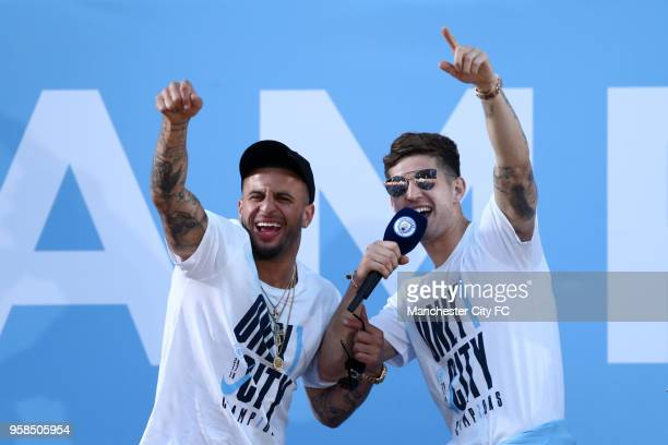 John Stones and Kyle Walker of Manchester City acknowledges the fans from the stage during the Manchester City Trophy Parade on May 14 2018 in...