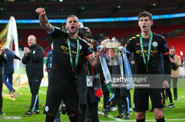 John Stones and Kyle Walker of Manchester City celebrate after victory over Aston Villa in the Carabao Cup Final between Aston Villa and Manchester...
