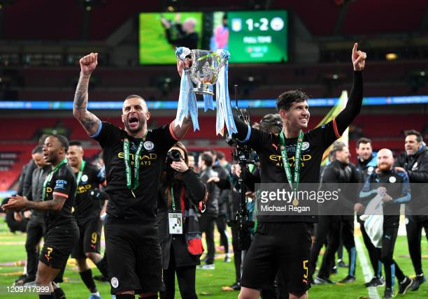 John Stones and Kyle Walker of Manchester City celebrate with The Carabao Cup trophy following their side's victory during the Carabao Cup Final...