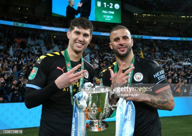 John Stones and Kyle Walker of Manchester City celebrate with the trophy after the Carabao Cup Final between Aston Villa and Manchester City at...